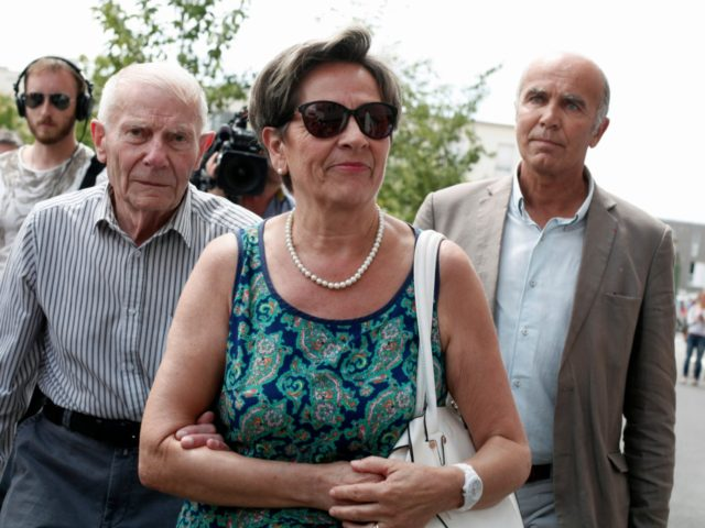 FILE - In this July 23, 2015 file photo, Viviane and Pierre Lambert, parents of Vincent Lambert, arrive at the Sebastopol hospital, in Reims, eastern France, where Vincent, who is currently on artificial life support, is hospitalized. France's highest administrative court has ruled that doctors can stop feeding and hydrating …
