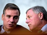 Senate Intelligence Chairman Richard Burr, R-N.C., right, speaks with Committee Vice Chairman Mark Warner, D-Va., left, during a Senate Intelligence Committee hearing on 'Policy Response to Russian Interference in the 2016 U.S. Elections' on Capitol Hill, Wednesday, June 20, 2018, in Washington. (AP Photo/Andrew Harnik)