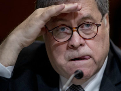 Attorney General William Barr reacts as he appears before a Senate Appropriations subcommittee to make his Justice Department budget request, Wednesday, April 10, 2019, in Washington. Barr said Wednesday that he was reviewing the origins of the Trump-Russia investigation. He said he believed the president's campaign had been spied on …