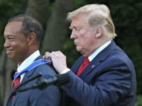 WASHINGTON, DC - MAY 06: U.S. President Donald Trump presents professional golfer and business partner Tiger Woods with the Medal of Freedom during a ceremony in the Rose Garden at the White House May 06, 2019 in Washington, DC. Trump announced he would give the nation's highest civilian honor to …
