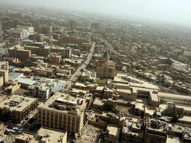 An aerial view shows Baghdad's al-Tayaran square on March 3, 2008. Five years after US-led troops swept across Iraq, Baghdad -- for centuries a beacon of culture in the Arab world, today a city under occupation divided by concrete walls -- refuses to see its spirit crushed. AFP PHOTO/PATRICK BAZ …