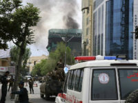Smoke billows from a building during an ongoing attack by Taliban militants on a compound housing and international aid organisation in Kabul on May 8, 2019. - A large blast rocked central Kabul Wednesday, officials confirmed, sending a plume of black smoke over the city in the latest explosion to …