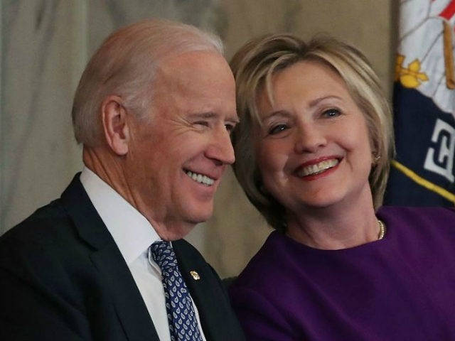 Former US Secretary of State, Hillary Clinton shares a laugh with US Vice President Joseph Biden, during a portrait unveiling ceremony for outgoing Senate Minority Leader Harry Reid (D-NV), on Capitol Hill December 8, 2016 in Washington, DC. (Photo by Mark Wilson/Getty Images)