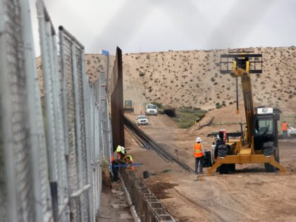 US workers replace fencing with a higher new metal wall along the border between Ciudad Juarez and Sunland Park, New Mexico, in Juarez, Chihuahua state, Mexico on September 12, 2016. / AFP / HERIKA MARTINEZ (Photo credit should read HERIKA MARTINEZ/AFP/Getty Images)