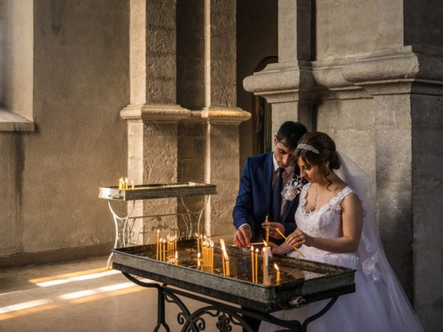 Groom Davit Simonyan, 24, and bride Shogher Hovsepyan, 25, light candles in prayer after their wedding at Ghazanchetsots church on April 18, 2015 in Shushi, Nagorno-Karabakh. Since signing a ceasefire in a war with Azerbaijan in 1994, Nagorno-Karabakh, officially part of Azerbaijan, has functioned as a self-declared independent republic and …