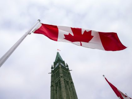 A Canadian flag flies in front of the peace tower on Parliament Hill in Ottawa, Canada on December 4, 2015, as part of the ceremonies to the start Canada's 42nd parliament . AFP PHOTO/GEOFF ROBINS / AFP / GEOFF ROBINS (Photo credit should read GEOFF ROBINS/AFP/Getty Images)