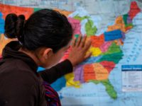 A Guatemalan woman touches a map of the United States at the Casa del Refugiado, or The House of Refugee, a new centre opened by the Annunciation House to help the large flow of migrants being released by the United States Border Patrol and Immigration and Customs Enforcement in El …