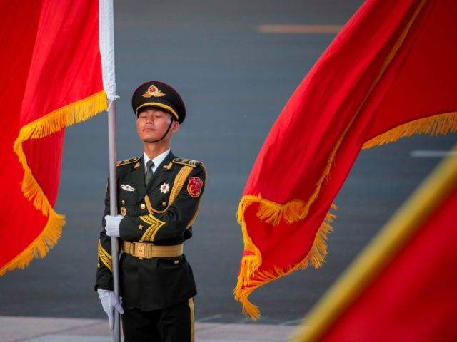 A Chinese honour guard holds a flag ahead of a welcome ceremony for Niger President Mahamadou Issoufou (not pictured) at the Great Hall of the People in Beijing on May 28, 2019. (Photo by NICOLAS ASFOURI / AFP) (Photo credit should read NICOLAS ASFOURI/AFP/Getty Images)