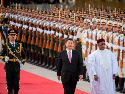 Niger President Mahamadou Issoufou (R) and Chinese President Xi Jinping (C) inspect honour guards during a welcome ceremony at the Great Hall of the People in Beijing on May 28, 2019. (Photo by NICOLAS ASFOURI / AFP) (Photo credit should read NICOLAS ASFOURI/AFP/Getty Images)