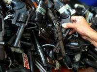 Confiscated loose firearms are presented to the media during a press briefing at the headquarters of the Philippine National Police (PNP) in Quezon City, suburban Manila on August 17, 2009. PNP Director General Jesus Versoza said at a gun control press briefing, over one million unlicensed firearms are in the …