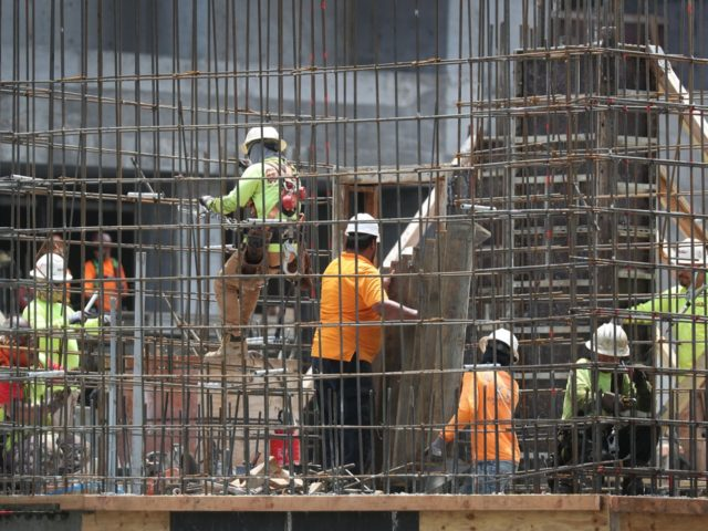 MIAMI, FLORIDA - MAY 03: Construction workers are seen at work on May 03, 2019 in Fort Lauderdale, Florida. The Labor Department released the month of April hiring and unemployment data that showed 263,000 jobs were created last month which beat analysts expectations and dropped the unemployment rate to 3.6 …