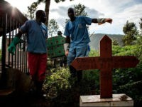 Health workers carry a coffin containing a victim of the Ebola virus on May 16, 2019 in Butembo. - The city of Butembo is at the epicentre of the Ebola crisis, the death toll of the outbreak to date is now over 1000 deaths. The Red Cross warned that critical …
