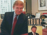 "Donald Trump, the New York developer, poses in his Manhattan office beside a copy of his new book, ""Trump: The Art of the Comeback."" Trump has been promoting the book, in which he tells how he returned from near bankruptcy to a personal net worth estimated at $1.4 billion by …"