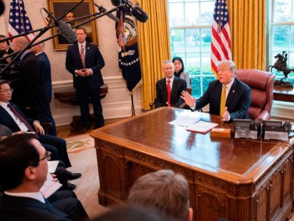 US President Donald Trump (R) speaks during a trade meeting with China's Vice Premier Liu He (C) in the Oval Office at the White House in Washington, DC, on April 4, 2019. (Photo by Jim WATSON / AFP) (Photo credit should read JIM WATSON/AFP/Getty Images)
