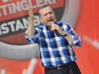 Turkish Prime Minister Recep Tayyip Erdogan makes a speach to supporters during a rally on June 16, 2013, in Istanbul. Turkish Prime Minister Recep Tayyip Erdogan rallied tens of thousands of his supporters in Istanbul on Sunday, hours after ordering a crackdown on anti-government protesters in a city park and …