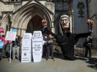 Supporters from the group Distant Voices, who oppose the liberalisation of euthanasia laws, demonstrate with a giant puppet of a judge outside the Royal Courts of Justice, Strand on July 17, 2017 in London, England. Noel Conway, 67, who is terminally ill with motor neurone disease, is seeking a legal …