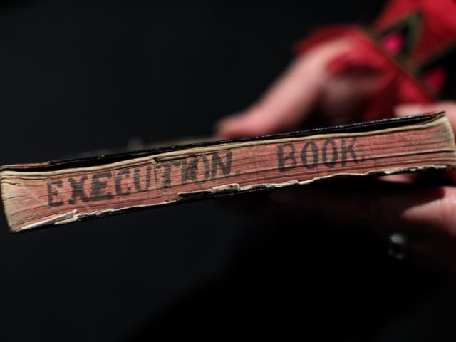 BILLINGSHURST, ENGLAND - MAY 30: An employee holds hangman Henry Pierrepoint's execution notebook from a collection of crime memorabilia linked to his son and executioner Albert Pierrepoint (estimate £25,000 - 40,000) during a press preview at Summers Place Auctions on May 30, 2018 in Billingshurst, England. Summers Place Auctions are …