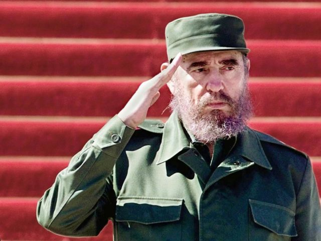HAVANA, CUBA: Cuban President Fidel Castro (R) and Cambodia's Prime Minister Samdech Hun Sen (L) salute a passing honor guard during a welcome ceremony at the State Council in Havana 09 September 1999. Hun Sen is on a four-day official visit to Cuba following Castro's invitation. (ELECTRONIC IMAGE) AFP PHOTO/ADALBERTO …