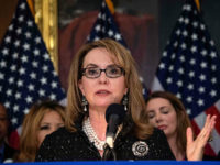 Former US Representative Gabrielle Giffords, who was shot in the head in 2011, speaks at a press conference to introduce legislation on expanding background checks for gun sales at the Capitol in Washington, DC, on January 8, 2019. (Photo by NICHOLAS KAMM / AFP) (Photo credit should read NICHOLAS KAMM/AFP/Getty …