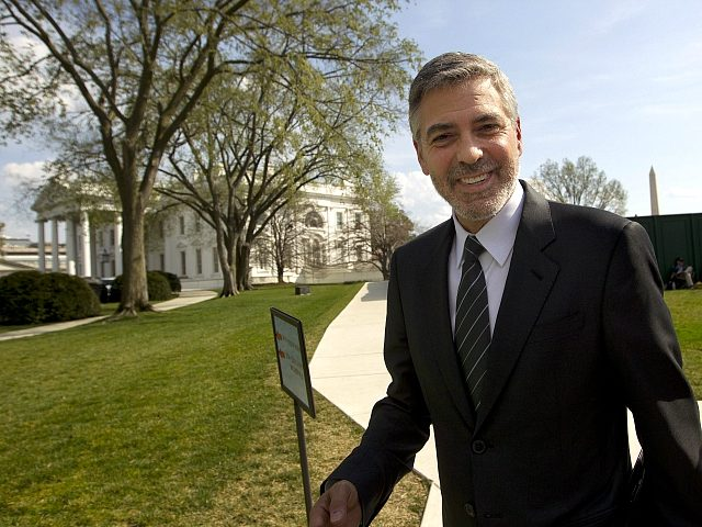 Actor George Clooney leaves the White House in Washington, Thursday, March, 15, 2012, after his meeting with President Barack Obama. (AP Photo/Pablo Martinez Monsivais)