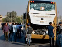 A picture taken on May 19, 2019, shows a bus damaged during a bomb blast near Egypt's famed Giza pyramids. - A bomb blast hit a tourist bus wounding at least 17 people, including South Africans, in the latest blow to the country's tourism industry. The roadside bomb went off …