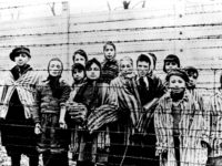 The file picture taken just after the liberation by the Soviet army in January, 1945 shows a group of children wearing concentration camp uniforms including Martha Weiss who was ten years-old, 6th from right, at the time behind barbed wire fencing in the Oswiecim (Auschwitz) Nazi concentration camp. The German …