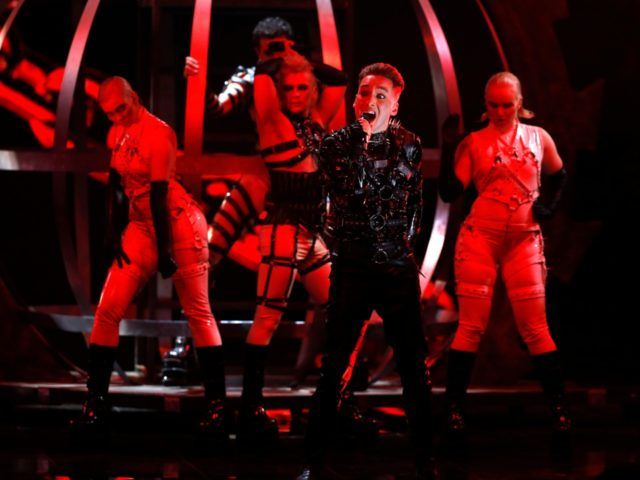 "Hatari of Iceland perform the song ""Hatrio mun sigra"" during the 2019 Eurovision Song Contest grand final in Tel Aviv, Israel, Saturday, May 18, 2019. (AP Photo/Sebastian Scheiner)"