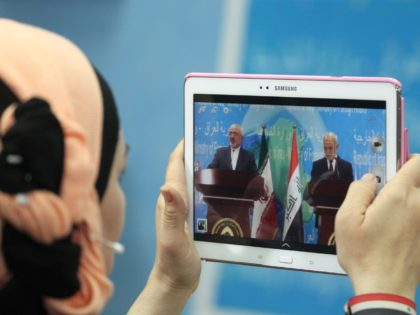 An Iraqi journalist takes a photo of Iranian Foreign Minister Mohammad Javad Zarif (L) during a press conference with Iraqi Foreign Minister Ibrahim al-Jaafari in the Iraqi capital Baghdad on February 24, 2015. AFP PHOTO / SABAH ARAR (Photo credit should read SABAH ARAR/AFP/Getty Images)