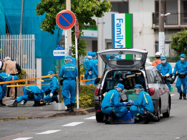 Police forensic experts work at the crime scene where a man stabbed 19 people, including children in Kawasaki on May 28, 2019. - A knife-wielding attacker killed a 12-year-old schoolgirl and a man before stabbing himself to death in a rampage outside Tokyo on May 28 that also injured more …