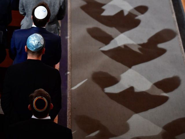Men wearing Jewish kippa skullcaps attend a ceremony at the Synagogue Rykestrasse in Berlin on November 9, 2018 to commemorate the 80th anniversary of the Kristallnacht Nazi pogrom. - Germany remembers victims of the Nazi pogrom that heralded the start of the Third Reich's drive to wipe out Jews, at …