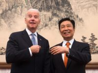 BEIJING, CHINA - DECEMBER 05: U.S. Vice President Joe Biden (L), and his Chinese counterpart Li Yuanchao share a light moment before heading to their luncheon at the Diaoyutai State Guesthouse on December 5, 2013 in Beijing, China. U.S Vice President Joe Biden is on an official visit to China …