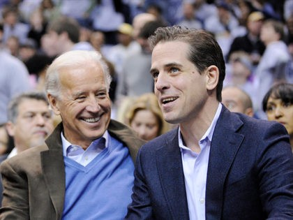 President Barack Obama, left, talks with Vice President Joe Biden, center, and his son Hunter Biden, right, at the Duke Georgetown NCAA college basketball game, Saturday, Jan. 30, 2010, in Washington. (AP Photo/Nick Wass)