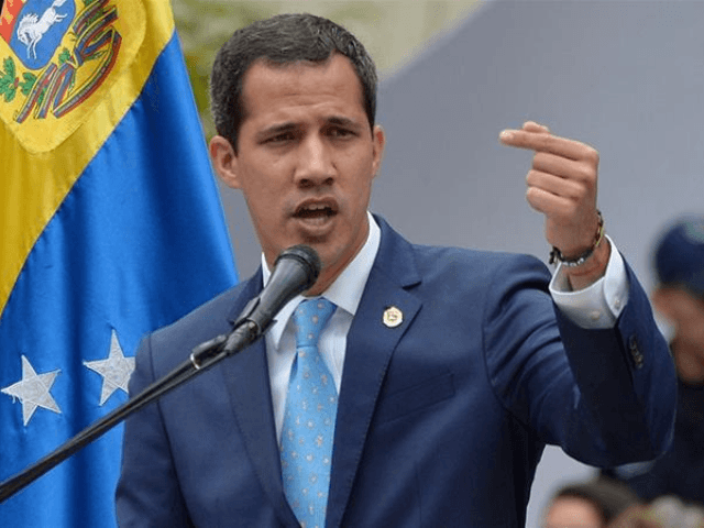 Venezuelan opposition leader and self-proclaimed interim president Juan Guaido addresses supporters during a meeting in Caracas [Federico Parra/AFP]