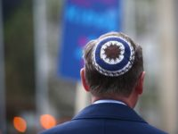 Thuringia's State Premier Bodo Ramelow wears a kippa during a rally in Erfurt, central Germany, on April 25, 2018. - Germans stage shows of solidarity with Jews after a spate of shocking anti-Semitic assaults, raising pointed questions about Berlin's ability to protect its burgeoning Jewish community seven decades after the …