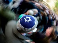 "A participant of the ""Berlin wears kippa"" rally wears a kippa in Berlin on April 25, 2018. - Germans stage shows of solidarity with Jews after a spate of shocking anti-Semitic assaults, raising pointed questions about Berlin's ability to protect its burgeoning Jewish community seven decades after the Holocaust. (Photo …"