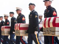 HONOLULU, HI - AUGUST 01: U.S. military carry the presumed remains of Korean War soldiers at Hangar 19 Joint base Pearl Harbor Hickam on August 1, 2018 in Honolulu, Hawaii. The remains of 55 service members were flown to Hawaii after being handed over by North Korea. (Photo by Kat …