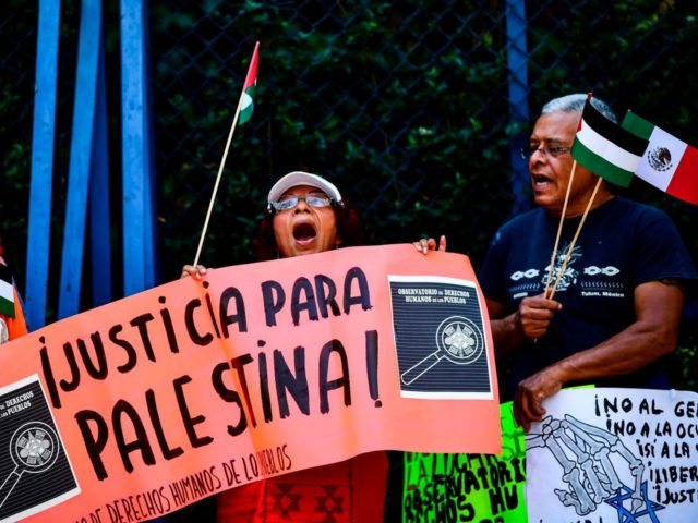 Members of the Palestinian community and sympathizers take part in a protest against Israel at the Angel de la Independencia square, in Mexico City, on May 14, 2018. (Photo by RONALDO SCHEMIDT / AFP) (Photo credit should read RONALDO SCHEMIDT/AFP/Getty Images)