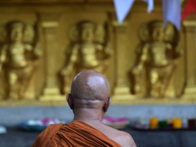 "A Sri Lankan's Buddhist monk prays for the bomb blast victims at Kelaiya temple in Colombo on April 24, 2019, three days after a series of suicide attacks targeting churches and luxury hotels in Sri Lanka. - Sri Lanka's government on April 24 acknowledged ""major"" lapses over its failure to …"