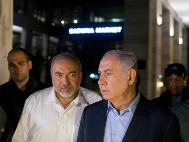 Israeli Prime Minister Benjamin Netanyahu (R) and Defence Minister Avigdor Liberman speak to the press at the scene of a shooting outside Max Brenner restaurant in Sarona Market on June 8, 2016 in Tel Aviv, Israel. According to police reports, four Israelis were killed and several others wounded when two …