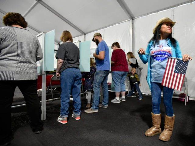 LAS VEGAS, NV - NOVEMBER 06: Election worker Leah Barney (R) watches over voters as they cast their ballots on November 6, 2018 in Las Vegas, Nevada. Turnout is expected to be high nationwide as Democrats hope to take back control of at least one chamber of Congress. (Photo by …
