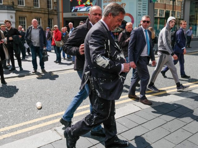 Brexit Party leader Nigel Farage has what is thought to have been a milkshake thrown over him as he visits Northumberland Street in Newcastle Upon Tyne during a whistle stop UK tour on May 20, 2019 in Newcastle Upon Tyne, England. His visit to Newcastle comes ahead of the 2019 …