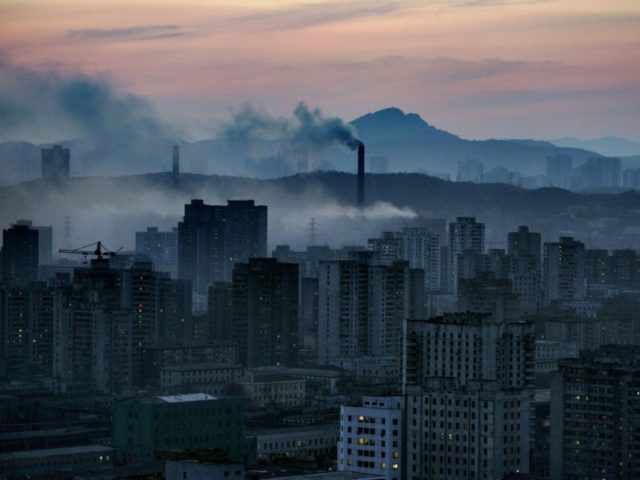 A view of the North Korean capital Pyongyang shows huge steam clouds from coal powered power plants, 24 March 2005. South Korea confirmed 18 April 2005 the shutdown of North Korea's five-megawatt reactor at the Yongbyon nuclear power plant complex, 90 kilometers (50 miles) north of the capital Pyongyang, a …