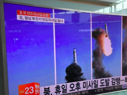People walks past a television showing a news report on North Korea's latest missile test of a Pukguksong-2, at a railway station in Seoul on May 22, 2017. North Korea on May 22 declared its medium-range Pukguksong-2 missile ready for deployment after a weekend test, the latest step in its …