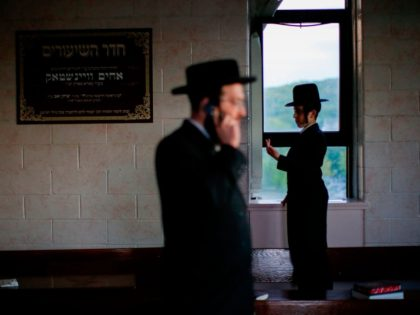 TOPSHOT - Orthodox Jews of the Satmar Hasidim arrive to celebrate the Jewish holiday of Lag Ba'Omer, which marks the anniversary of the death of Talmudic sage Rabbi Shimon Bar Yochai approximately 1,900 years ago, in the village of Kiryas Joel, New York, May 14, 2017. (Photo by EDUARDO MUNOZ …