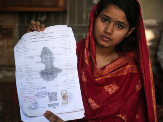 In this April 14, 2019 photo, Mahek Liaqat, who married a Chinese national, shows her marriage certificate in Gujranwala, Pakistan. Poor Pakistani Christian girls are being lured into marriages with Chinese men, whom they are told are Christian and wealthy only to end up trapped in China, married to men …