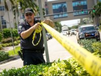 HOLLYWOOD, FL - SEPTEMBER 13: A Hollywood Police Department officer wraps crime scene tape around a perimeter surrounding a rehabilitation center where six patients were found dead September 13, 2017 in Hollywood, Florida. The deaths may be due to to the home's loss of air conditioning after Hurricane Irma struck …