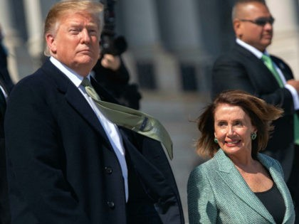 US President Donald Trump walks alongside Speaker of the House Nancy Pelosi as he departs following the Friends of Ireland Luncheon in honor of Irish Prime Minister Leo Varadkar at the US Capitol in Washington, DC, March 14, 2019. (Photo by SAUL LOEB / AFP) (Photo credit should read SAUL …