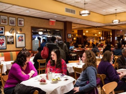 NEW YORK, NY - FEBRUARY 21: Women wait for their food at Junior's restaurant, a staple of Brooklyn dining since the 1950s, on February 21, 2014 in the Downtown Brooklyn neighborhood of the Brooklyn borough of New York City. The restaurant recently announced it would be closing - many assume …