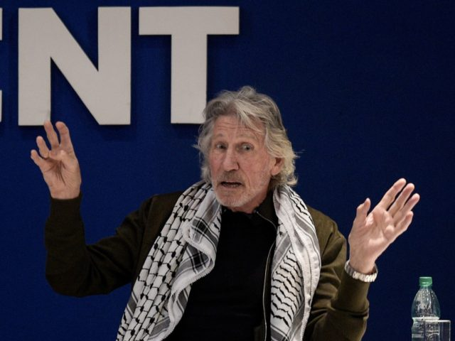 British rock icon and activist Roger Waters, gestures during a conference on Palestinian situation and Human Rights at the Uruguayan unions' organization (PIT-CNT) headquarters in Montevideo, on November 02, 2018. - The Pink Floyd's founder is visiting the Uruguayan capital to offer a concert. (Photo by MIGUEL ROJO / AFP) …