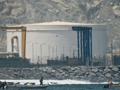 "fisherman prepares his boat near an oil storage tank in Fujairah, United Arab Emirates, Monday, May 13, 2019. Saudi Arabia said Monday two of its oil tankers were sabotaged off the coast of the United Arab Emirates near Fujairah in attacks that caused ""significant damage"" to the vessels, one of …"